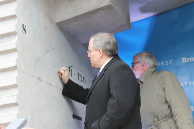 <p>Manhattan Borough President Scott Stringer signs the concrete slab that will make up part of the platform over the rail yards.</p>