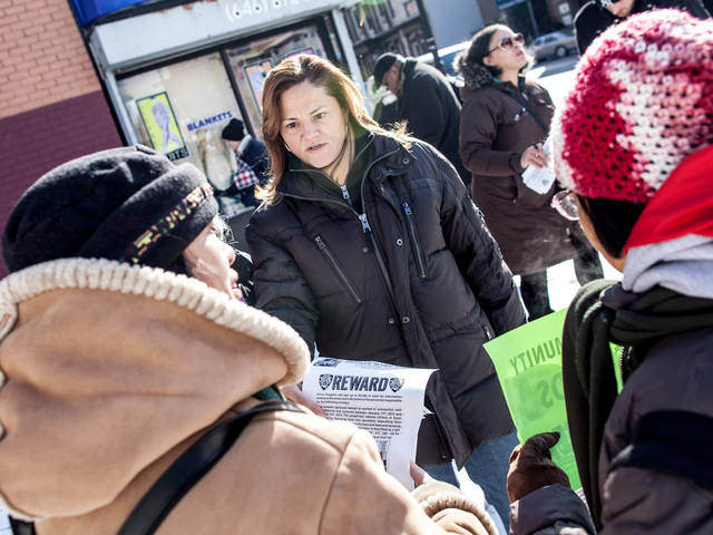 <p>Councilwoman Melissa Mark-Viverito hands out fliers and urges neighbors to raise awareness about a rash of muggings in East Harlem, on Jan. 26, 2013.</p>