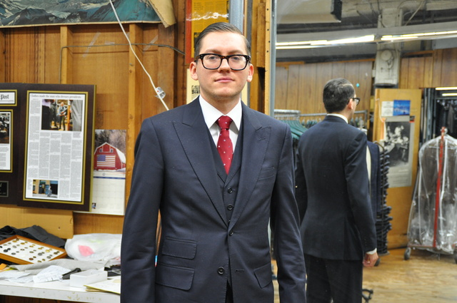 <p>Will Brennan, a Martin Greenfield tailor who is working on the Ghurka partnership, donned one of the company&#39;s suits at the workshop.</p>