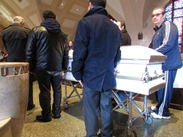 <p>Pallbearers bring in the casket of Miguel Torres, who was killed by a dump truck in December.</p>