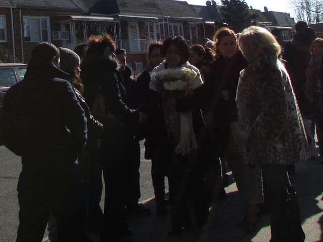 <p>Mourners gather to support Elia&nbsp;Zubizarreta, mother of Miguel Torres, 11, who was killed by a dump truck in December.</p>