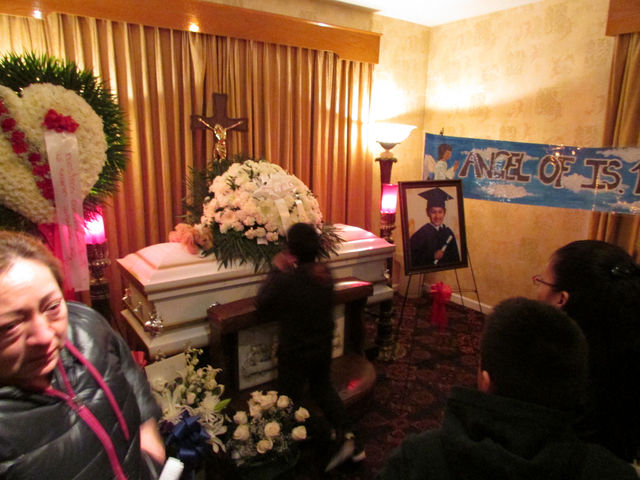 <p>A child prays at Miguel Torres&#39; coffin during the 11-year-old&#39;s wake.</p>