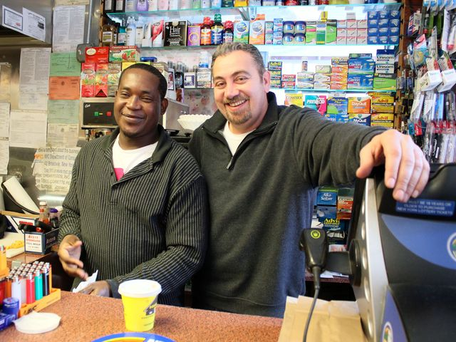 <p>Mike Ahal, a Palestinian immigrant who owns Poppy&#39;s Gourmet Corner on Avenue A and East 12th Street, and one of his employees.</p>