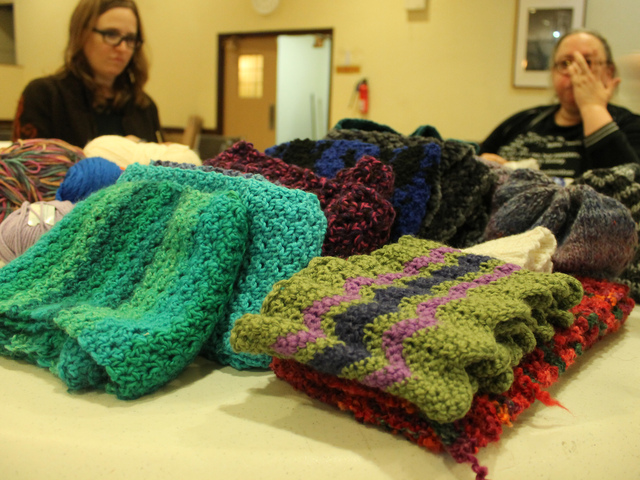 <p>Volunteers knitted and crocheted two dozen hats, scarves, gloves and quilt squares for homeless LGBT youth.</p>