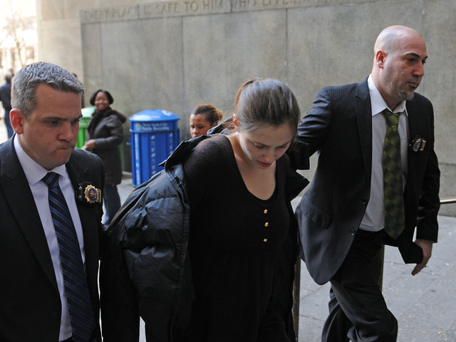 <p>Morgan Gliedman, 27, is led into Manhattan Criminal Court to be arraigned after police allegedly found explosive materials in her Greenwich Village apartment, Jan. 8, 2013.</p>