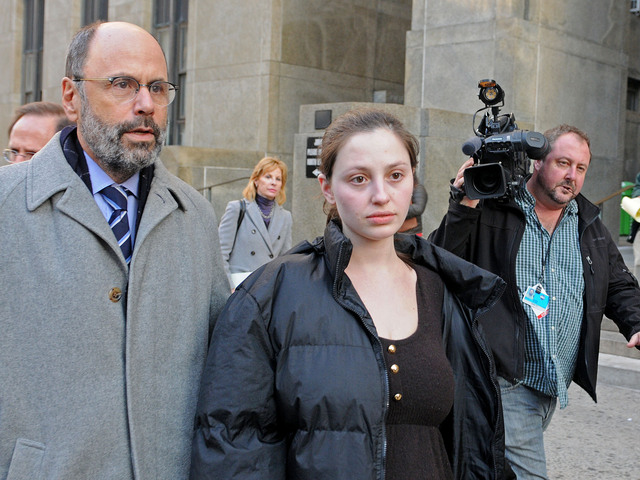 <p>Morgan Gliedman, 27, leaves Manhattan Criminal Court with her lawyer, Gerald Shargel, after she was arraigned on weapons and explosives charges, Jan. 8, 2013.</p>