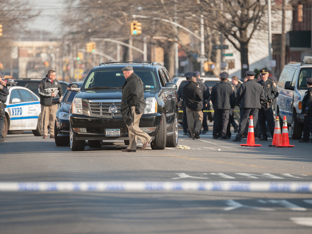 <p>Officers at the scene of the shooting on Clarendon Road near Utica Avenue on Tuesday, Jan. 8, 2013.</p>