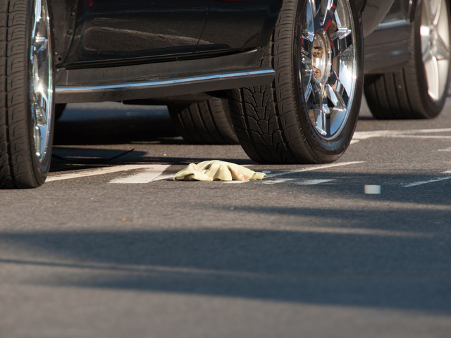 <p>Blood on the ground next to a Cadillac at the scene of a shooting Tuesday, Jan. 8, 2013.</p>