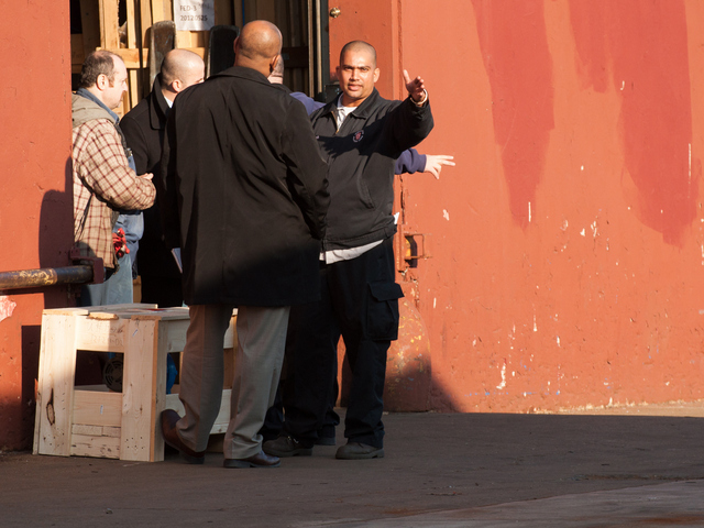 <p>Detectives talks to witnesses at the scene of a shooting near Utica Avenue Jan. 8, 2013.</p>