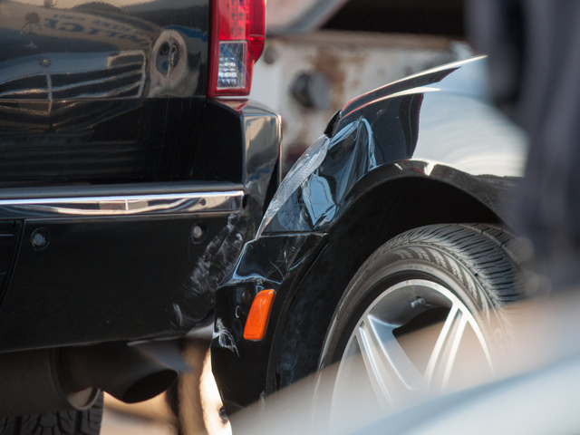<p>Damage is seen on the front left fender of the Mercedes S 550 and the rear bumper of the Cadillac Escalade at the scene of a shooting Jan. 8, 2013.</p>
