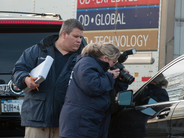 <p>Crime scene Investigators at the scene of the shooting Jan. 8, 2013.</p>