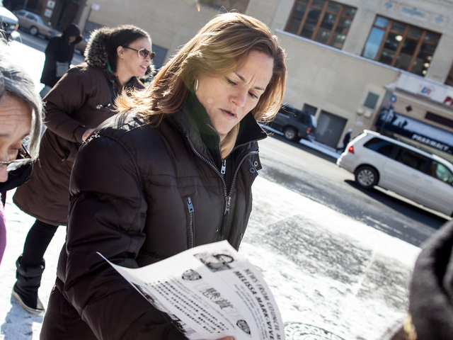 <p>Council Member Melissa Mark-Viverito reads a newspaper&#39;s account of a rash of violent muggings, all against Asian Americans, in East Harlem, on Jan. 26, 2013.</p>