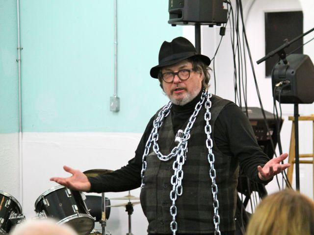<p>Bob Holman, of Bowery Poetry, speaks at a &quot;No 7-Eleven&quot; meeting.</p>