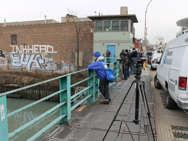 <p>Crowds of locals and news crews gathered on the Union Street bridge to watch the dolphin in the Gowanus Canal on Jan. 25, 2013.</p>