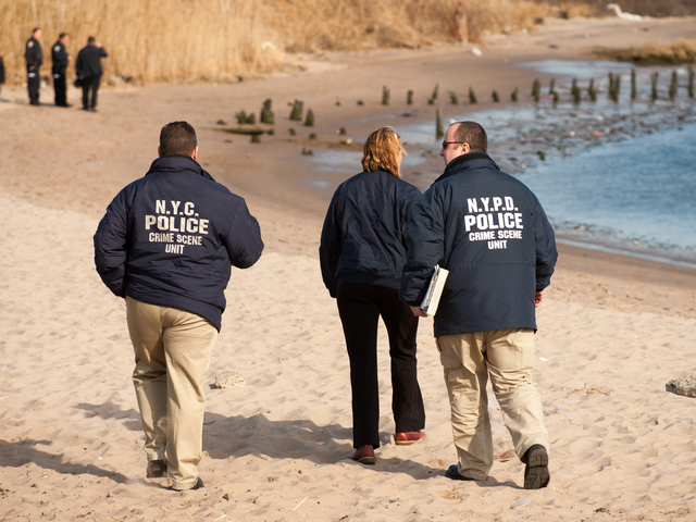 <p>Crime scene detectives arrive at Gerritsen Beach on Tuesday, Jan. 8, 2013.</p>