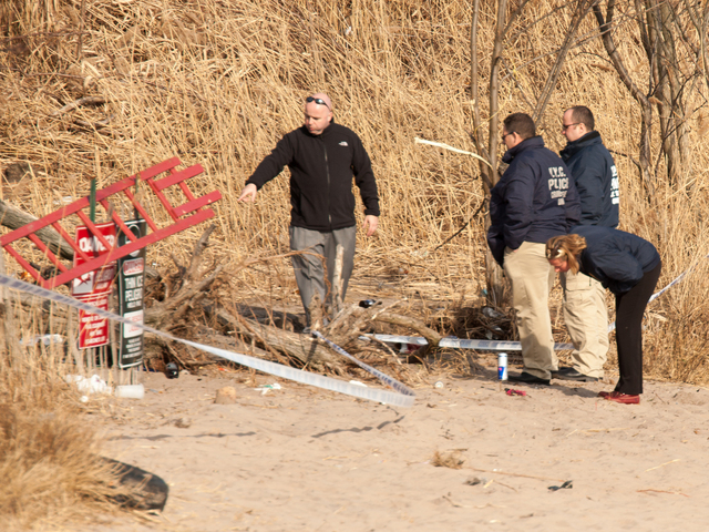 <p>Crime scene detectives check out possible evidence on Gerritsen Beach on Tuesday, Jan. 8, 2013.</p>