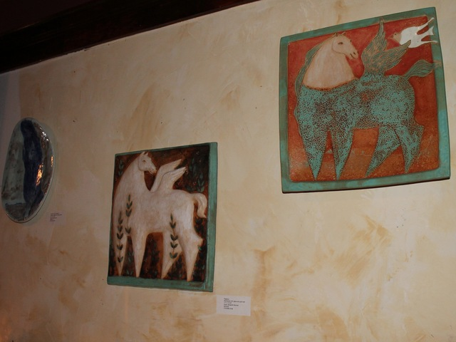 <p>The exhibit shows ceramic wall hangings.</p>