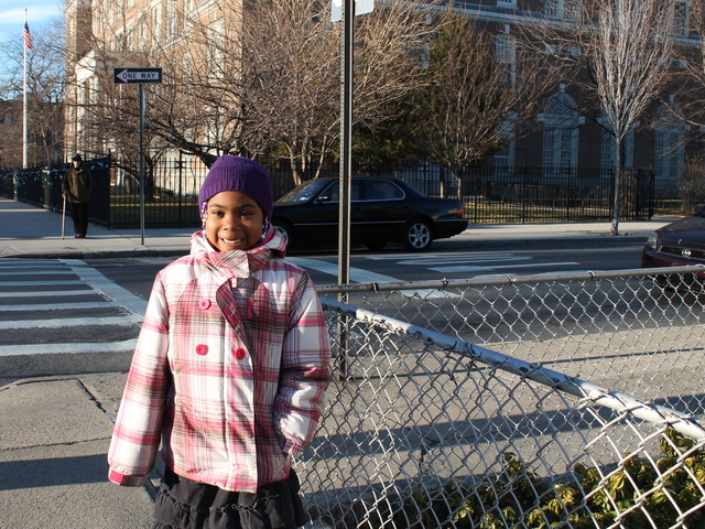 <p>Denim Bailey, 6, outside P.S. 122 in Astoria, where she attends first grade. Mom Tamy Bailey says she loves the school for its diverse student body.</p>