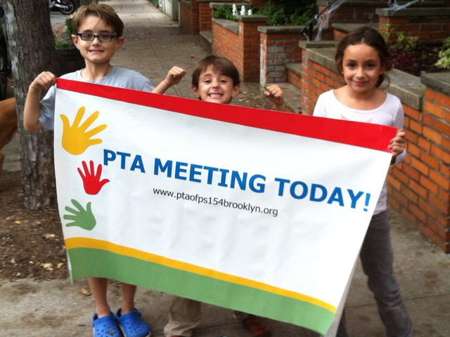 <p>Students at P.S. 154 in Windsor Terrace advertise a PTA meeting.</p>