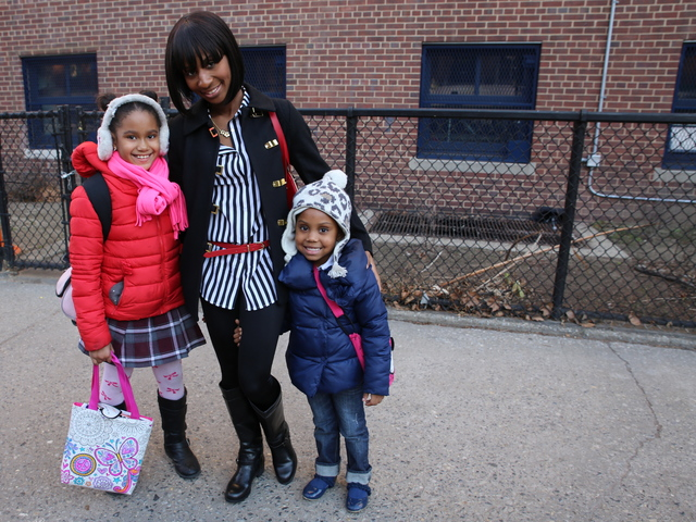 <p>Nyla Oliver, 4, poses with her mom Yvette Zimmerman and her cousin Demi Irving, 8, outside of P.S. 20 in Fort Greene.</p>
