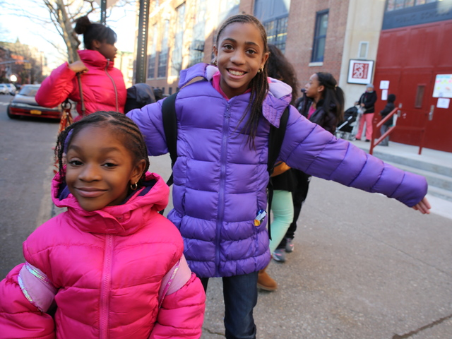 <p>Shelly Peoples, 11, and Anaya Morris, 6, pose outside Anaya&#39;s school, P.S. 20 in Brooklyn.</p>
