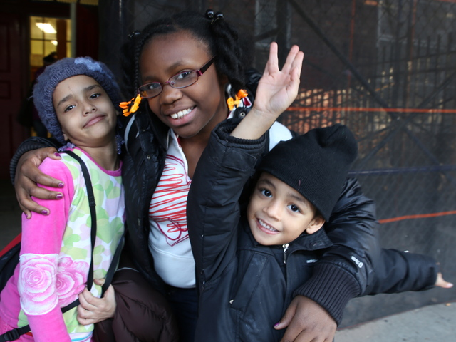 <p>Alexis Mallory, 8, and her brother Lamar, 4, pose for a picture with their friend Shoshana outside of P.S. 67 in Brooklyn.</p>