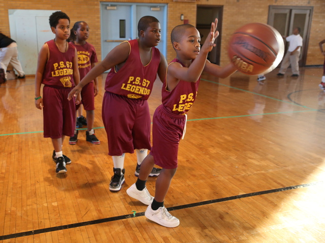 <p>Legends, P.S. 67&#39;s after-school basketball team, gears up for a game.</p>