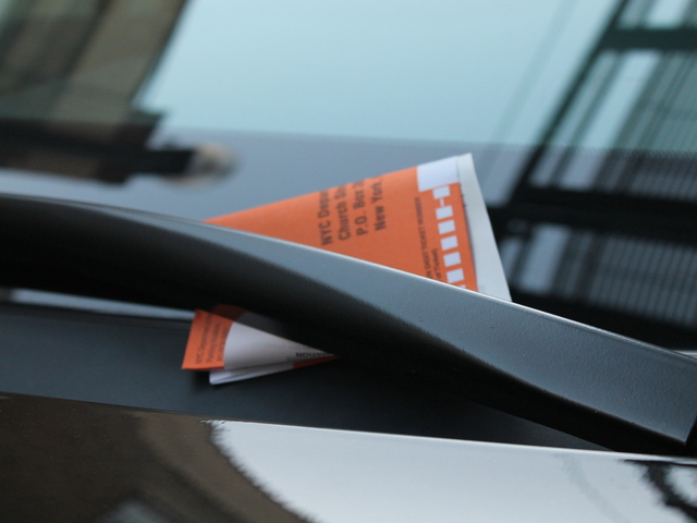 <p>A traffic ticket on the windshield of a car parked on Roosevelt Avenue on Jan. 7, 2013. No parking is permitted on weekdays between 4 and 7 p.m. on Roosevelt between 51st Street and 59th Street. Some say the rule is unnecessary.</p>