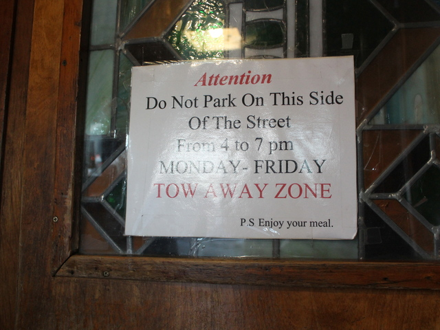 <p>A sign at Donovan&#39;s pub in Woodside. No parking is permitted on weekdays between 4 and 7 p.m. in front of the restaurant and for several blocks on the south side of Roosevelt Avenue, which Donovan&#39;s new owners say is bad for businesses.</p>