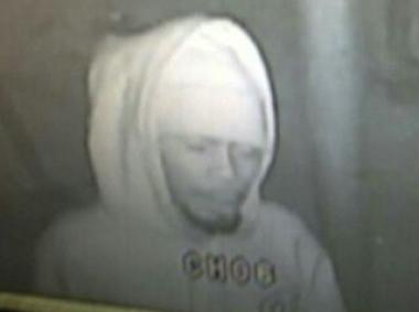 Police are looking for a man accused of robbing a Queens cleaners by gunpoint on Jan. 9. 2013.