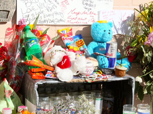 <p>A memorial for Raphael Ward has been created with candles, flowers and even some packs of his favorite snacks: Reese&#39;s Peanut Butter Cups and sunflower seeds.</p>