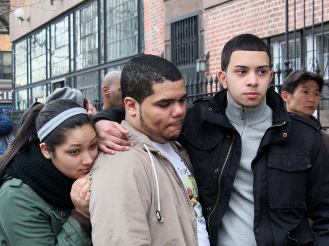 <p>Mourners at the wake for Raphael Ward, a 16-year-old who was shot and killed on Friday Jan. 4, 2013.</p>
