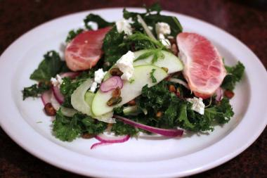 This raw kale salad combines the cruciferous vegetable with crunchy green apples, tangy Meyer lemon and salty roasted pistachios.