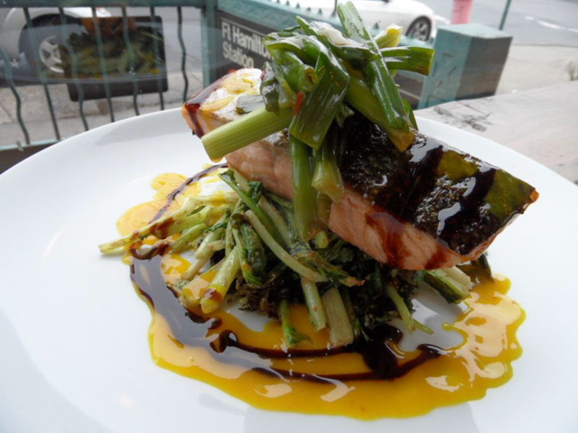 <p>Atlantic salmon, wilted mustard greens, with a mandarin orange gastrique at Brooklyn Commune.</p>
