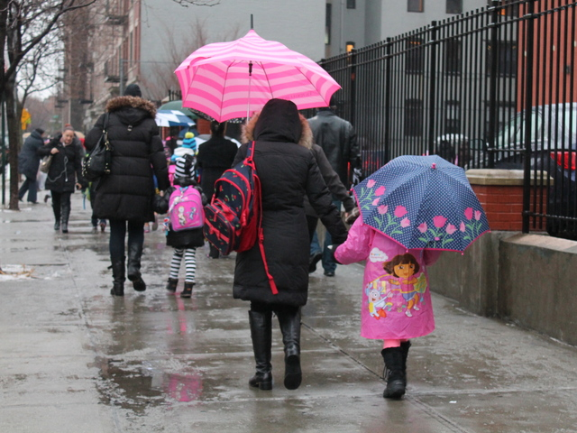<p>Parents walked their children to P.S. 17 in Astoria Wednesday morning, Jan. 16, 2013, during a strike by New York City school bus drivers.</p>