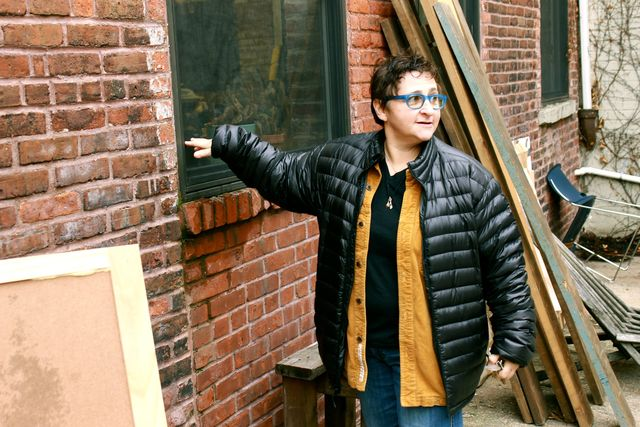 <p>Sheila Goloborotko shows how high the floodwater rose in her studio during Sandy.</p>