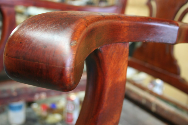 <p>Once the stain is down, go to town with the shellac. This is what brings out the rich shine and depth. Wood has a personality and there&#39;s no point in changing it. This chair had a natural reddish hue and zebra pattern.</p>