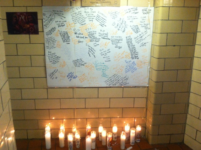 <p>A candlelight vigil in the lobby of the housing project where Elzina&nbsp;Brown and her daughter were shot on Jan. 2, 2012.</p>