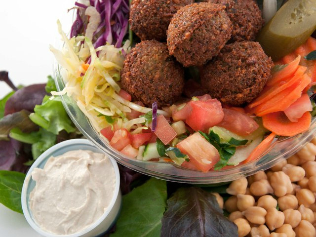 <p>At SoomSoom, diners can put falafel atop a salad, in a sandwich or on a platter.</p>