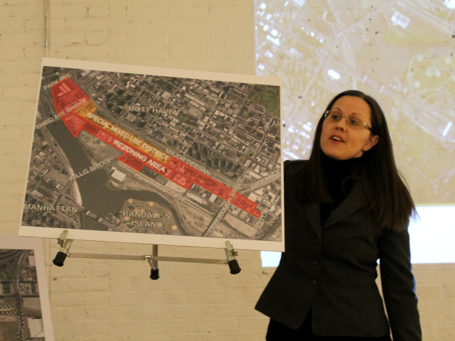 <p>Local resident and FreshDirect opponent Corrine Kohut shows a map of the Harlem River Yards and the surrounding neighborhood.</p>