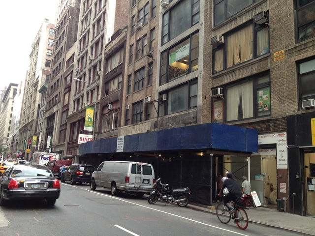 <p>Mark Yuan said this black construction netting cut off his restaurant from the rest of the street. In October, a judge ordered it to be taken down.</p>