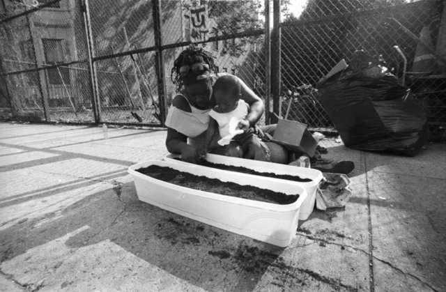 <p>Environmental activist Tanya Fields planting seeds with her son.</p>