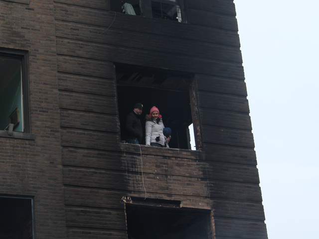<p>Charred windows in the aftermath of a three-alarm fire in Washington Heights on Jan. 25, 2013.</p>