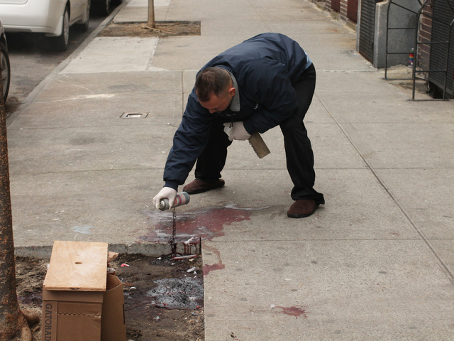 <p>Jose Quintanas, the superintendent at 75 Thayer St., cleans blood from the sidewalk where Edith Rojas was fatally stabbed on New Year&#39;s Eve.</p>