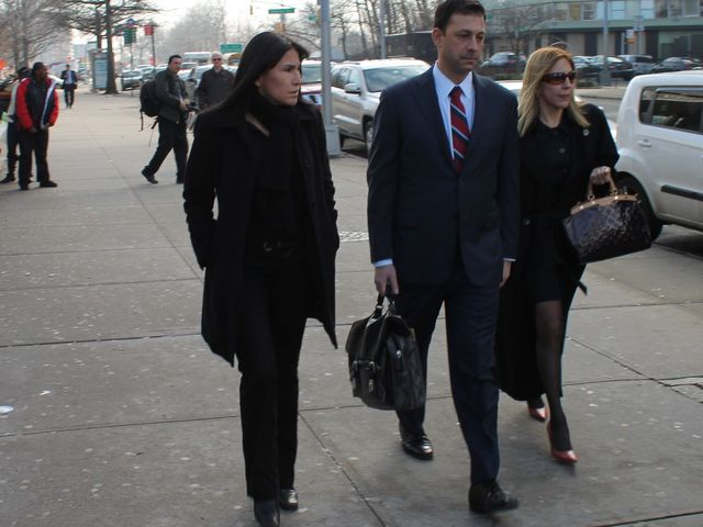 <p>Thomas Kenniff, the lawyer for accused subway pusher Erica Menendez, outside the court house on January 29, 2013, with Menendez&#39;s family members.</p>