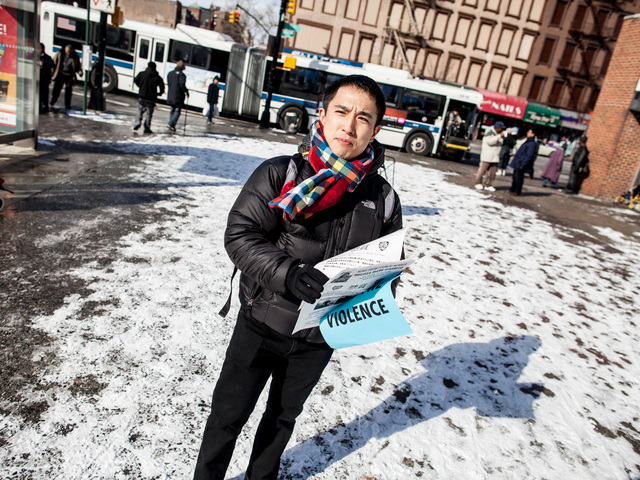 <p>A neighborhood resident of East Harlem hands out fliers supplied by Councilwoman Melissa Mark-Viverito&#39;s office on Jan. 26, 2013.</p>