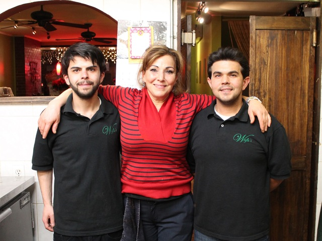 <p>Wafa Chami with her sons, Houssein (left) and Youssef, at their restaurant.</p>