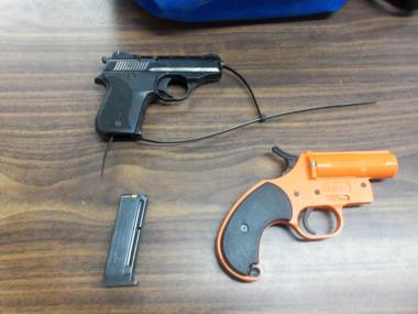 A 7-year-old is believed to have brought two guns to a Queens elementary school Thursday Jan. 17, 2013, handing an orange flare gun to another student, and keeping a .22-caliber handgun in his own backpack, cops said.