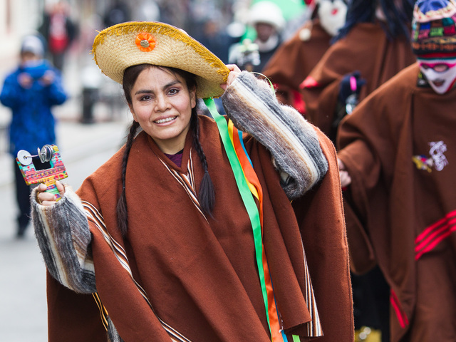 <p>A woman dressed in traditional Puerto Rican costume marches at the 36th Annual Three Kings Day Parade in East Harlem on Jan. 4, 2013.</p>