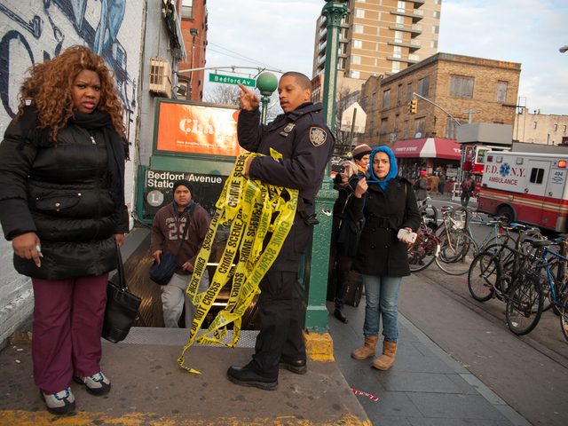<p>Commuters are directed off the platform at the Bedford Avenue stop for the L Train, where a woman was struck on Monday Jan. 21, 2013.</p>
